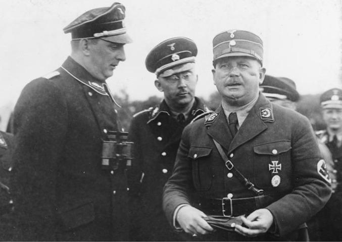 Kurt Delague, Heinreich Himmler und Ernst Röhm 1933 (v. l.)